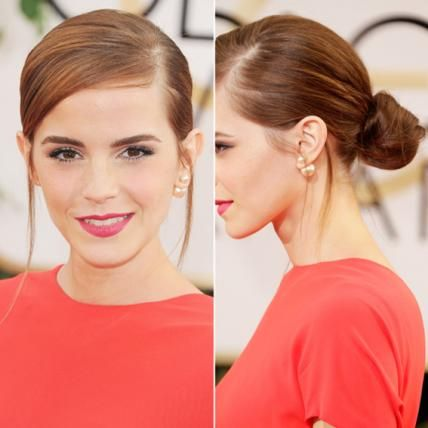 At the 2014 Golden Globes, Emma Watson's classic slicked back, side-parted bun contrasted with her open-back pants-dress combo by Dior.