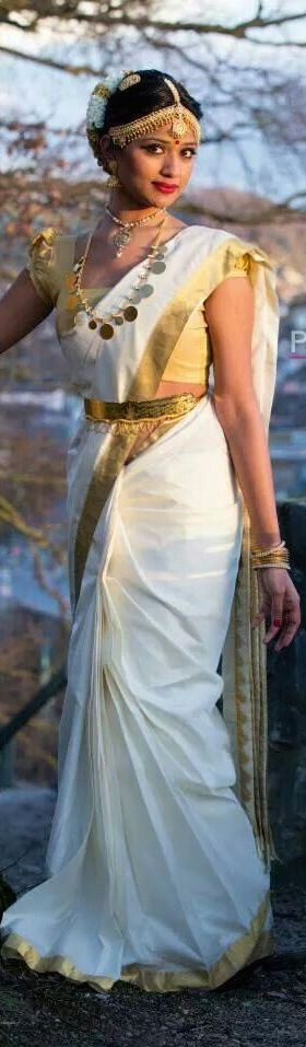 South Indian bride. Temple jewelry. Jhumkis.White silk kanchipuram sari.Braid with fresh jasmine flowers. Tamil bride. Telugu bride. Kannada bride. Hindu bride. Malayalee bride.Kerala bride.South Indian wedding