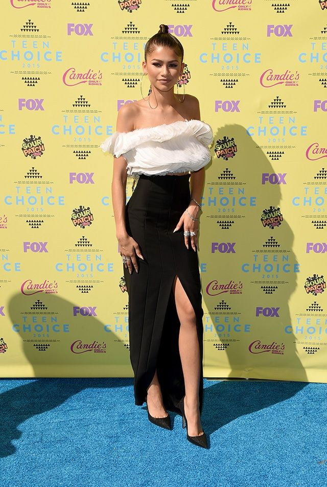 Zendaya in a ruffled top and black pencil skirt