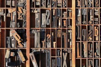 A box of old vintage printing press letter blocks