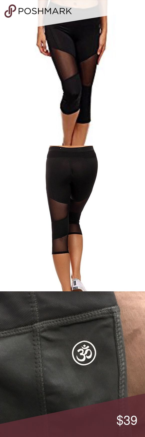 LA Society Mesh Cropped Ohm Yoga Pants Small This is a pair of LA Society Mesh Yoga Pants. Size small.  87% Polyester 13% Elastane new never worn.  Back-Zipper Pocket In Waistband Elasticized waistband Machine Washable 4-Way stretch material provides mobility for training and leisure activities. LA Society Pants Leggings