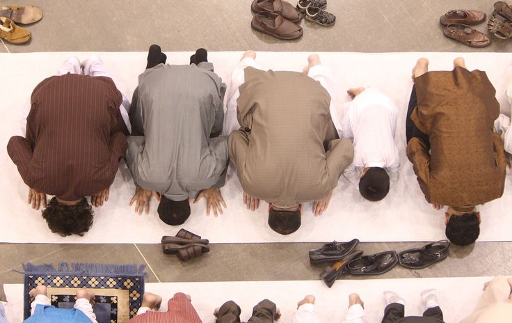Men pray during the Eid ul Fitr prayer service and celebration at the Reliant Center on Thursday, Aug. 8, 2013, in Houston. (AP Photo/Houston Chronicle, Mayra Beltran)