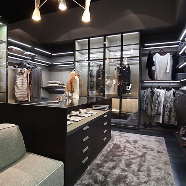 This walk in closet looks like a fitting room at a Department store!