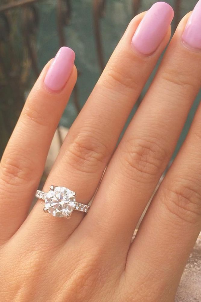 wedding ideas show off simple round cut engagement rings with pave band
