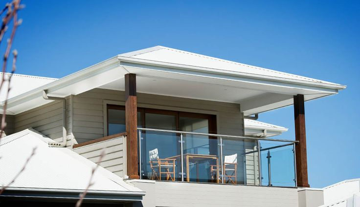 Upper storey balcony with white Colorbond roofing and Scyon Linea Weatherboard Cladding