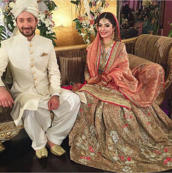 Pakistani bride & groom. Bride in House of Kamiar Rokni. Groom in traditional shalwar kameez, sherwani & pagri.