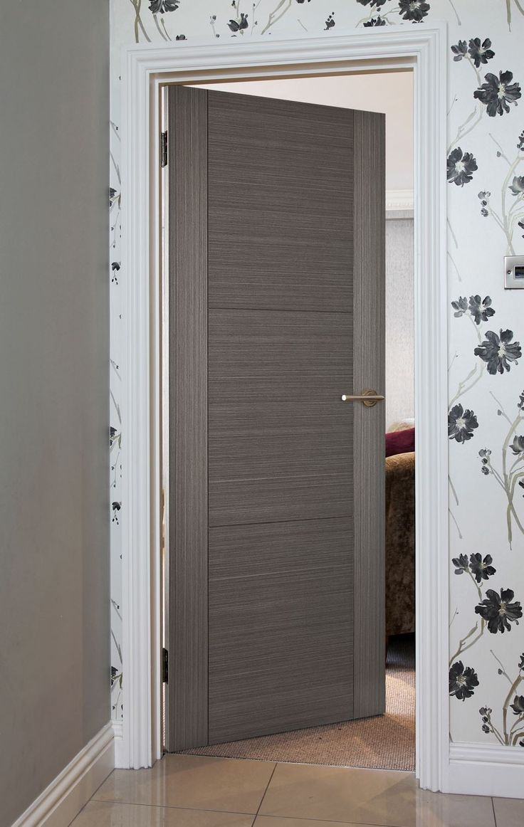 8400 GREY COTO (FD30) - A contemporary style fire door for modern homes. Door benefits from a v-groove detail into Grey Coto Door is manufactured using a Grey Coto veneer which is then Pre-finished in a clear lacquer.
