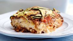 Recipe with video instructions: We combined all the wonderful summery flavors of ratatouille in this layered, noodle-free lasagna.      Ingredients: 2 tablespoons olive oil, 1 yellow onion, finely chopped, 3/4 pound Italian turkey, removed from casing, 1 red bell pepper, seeded and diced, 4 cloves garlic, minced, 2 cups marinara sauce, ¼ cup torn basil, 2 medium zucchini, 2 medium yellow squash, 1 medium eggplants, 1/3 cup extra-virgin olive oil, 1 (15 ounce) container part skim ric...
