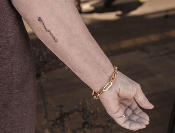 dezente tattoos männer