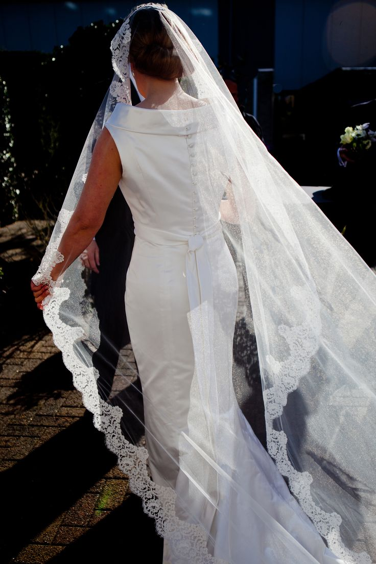 Silk satin, column wedding gown, with corded lace veil.