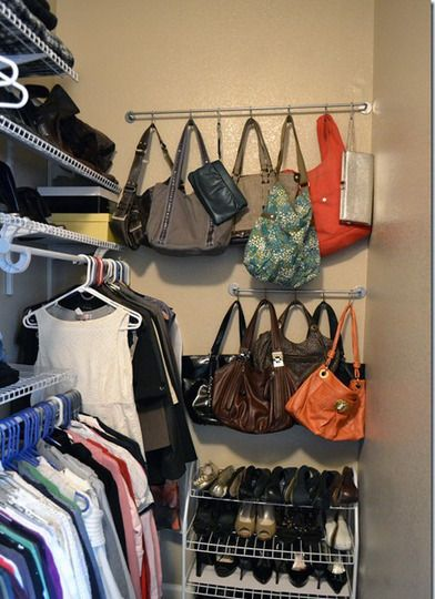 Try a towel bar with S-hooks for handbag storage.