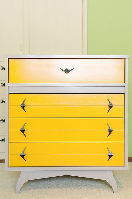 I now find myself in desperate need of mid-century dresser like this that I can paint tan/cream and yellow!!!!