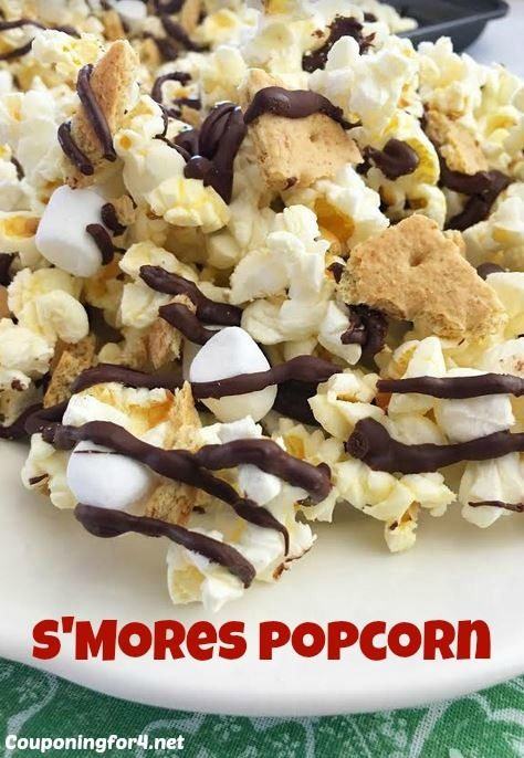 Easy S'mores Popcorn - This quick salty and sweet snack and dessert is amazing! This will take you only minutes to make, but with chocolate, marshmallows and graham crackers, it's an easy way to dress up the everyday movie pairing.