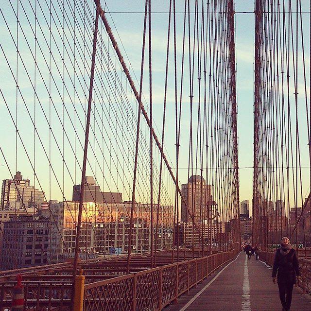 #nyc #newyorkcity #bridge #sunsets #brooklynbridge #brooklynart #womanup #up #likeitup #lookup #bluesky #blue #winteriscoming #orangesky #whatsgoingon #follow #me #onthebridge #iseefacesinthestrangestplaces #iseethelight #americanwoman #newyorkers #brooklynny #limitless #heavenonearth