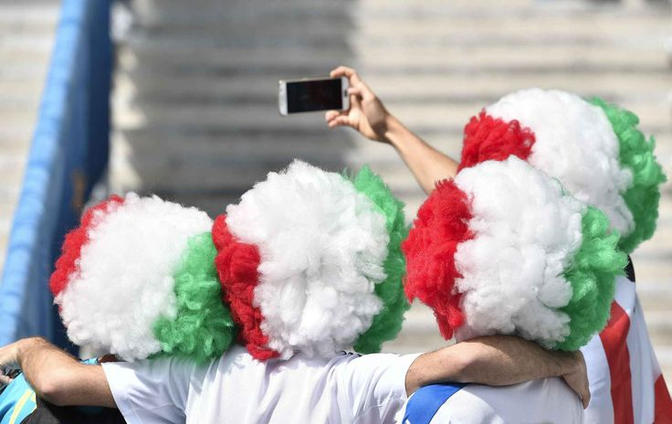 Italy supporters take a selfie on the stands before the Euro 2016 round of 16 soccer match between Italy and Spain, at the Stade de France, in Saint-Denis, north of Paris, Monday, June 27, 2016. (AP Photo/Martin Meissner)/TOU101/661824284882/1606271723