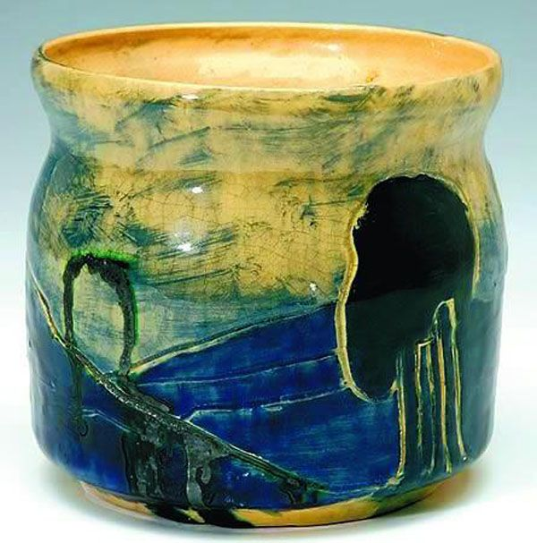 Merric Boyd vase, incised and glazed with a landscape in shades