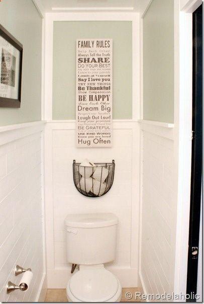 Extra tissue storage above the toilet.