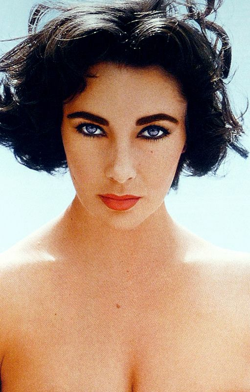Actress Elizabeth Taylor by photographer Richard Avedon (1956). I really like this photo as the lighting brings out her crystal blue eyes against her dark hair and make up.