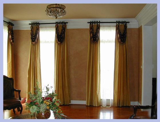Window treatment ideas in gold color that have similar color with the wall