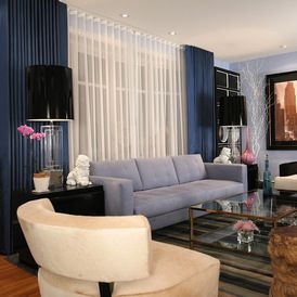 eclectic living room with ripple fold pleated curtains on double tracks
