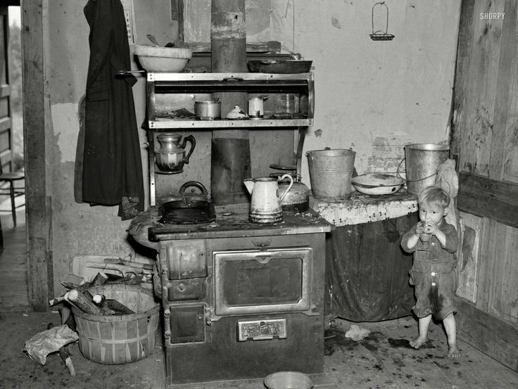 """June 1937. """"Child of Earl Taylor in the kitchen of their home near Black River Falls, Wisconsin.""""  Photo by Russell Lee From http://www.junipergallery.com/"""