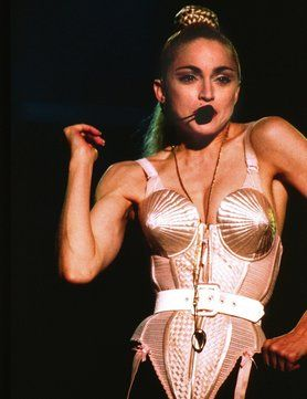 Madonna's Cone Bra (1990) Madonna is a fashion icon for the ages, but one of her most memorable (and most copied) signature looks was the cone bra that Jean Paul Gaultier designed for her Blond Ambition Tour in 1990.