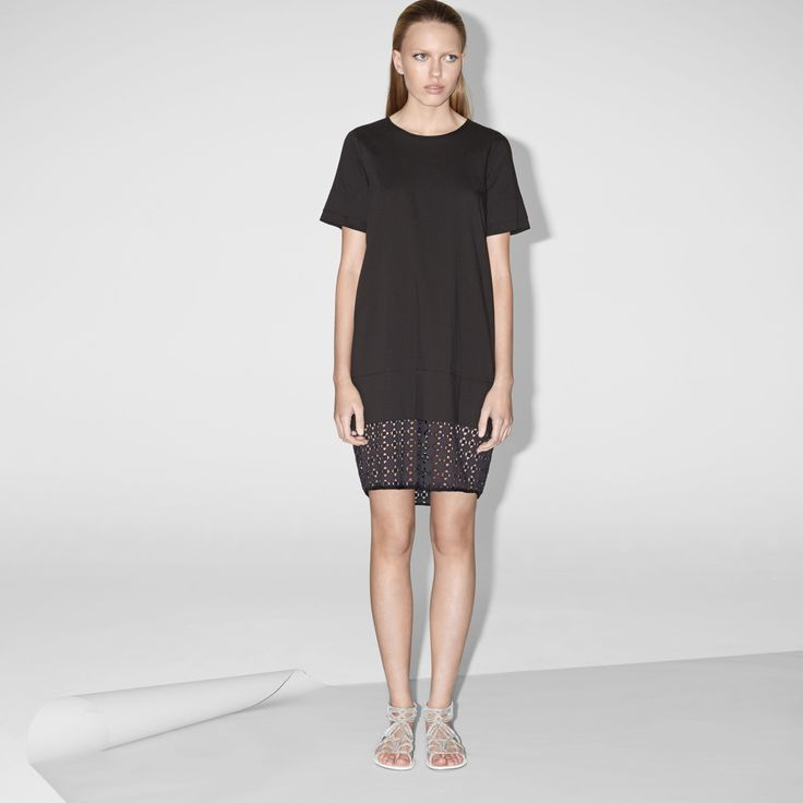 FWSS Nerve Ending is a shift dress in crisp cotton with layered cuff details and a lace panel at the hem.  http://fallwinterspringsummer.com/