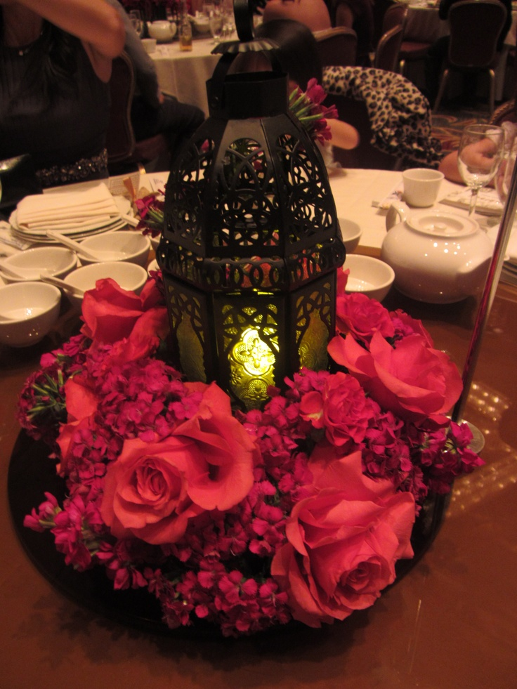 Wedding centerpiece lantern with flowers cousin s
