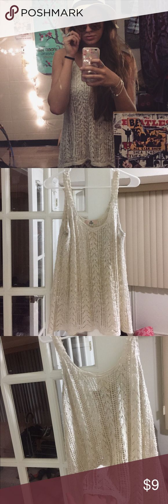 crochet tank top perfect condition, no flaws. goes well with a bandeau or bralette. I wore a nude bandeau to match the tank top so it covered my chest. Says medium but fits small if you want it a bit looser Tops Tank Tops
