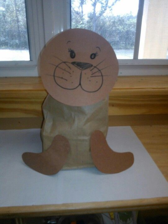 Seal craft made out of a paper bag and construction paper with a cute tail behind it. #kindergarten