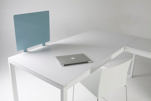 Our versatile MD desk is shown here with a magnetic privacy screen and extension.