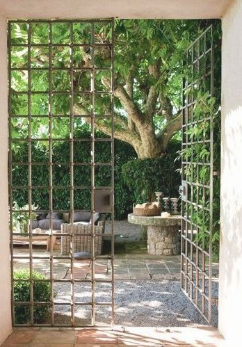 STUNNING ENTRANCE TO THIS COURT-YARD WITH BEAUTIFUL, YET SIMPLE STYLE IRON GATES