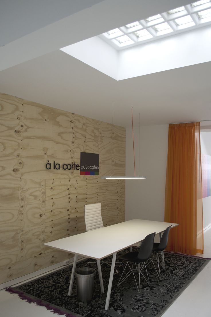 Back office with plywood wall