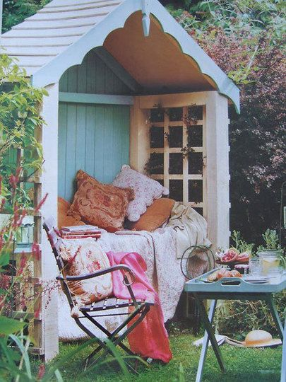I love the idea of converting a little garden shed into a whimsical, grown-up playhouse outfitted in airy curtains and comfy pillows.