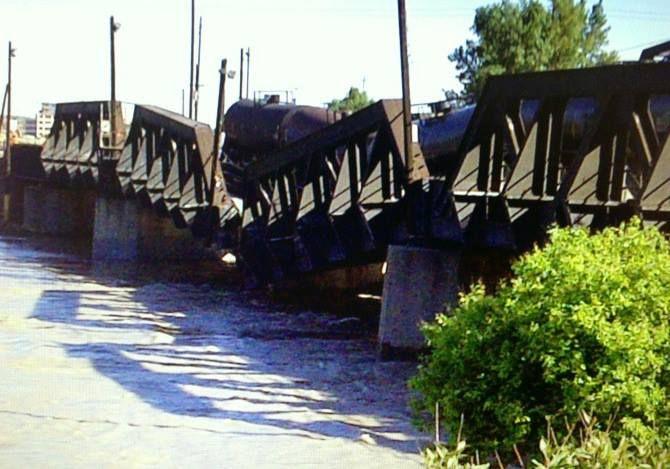 Calgary flood damage to rail bridge. They did not inspect it proper!