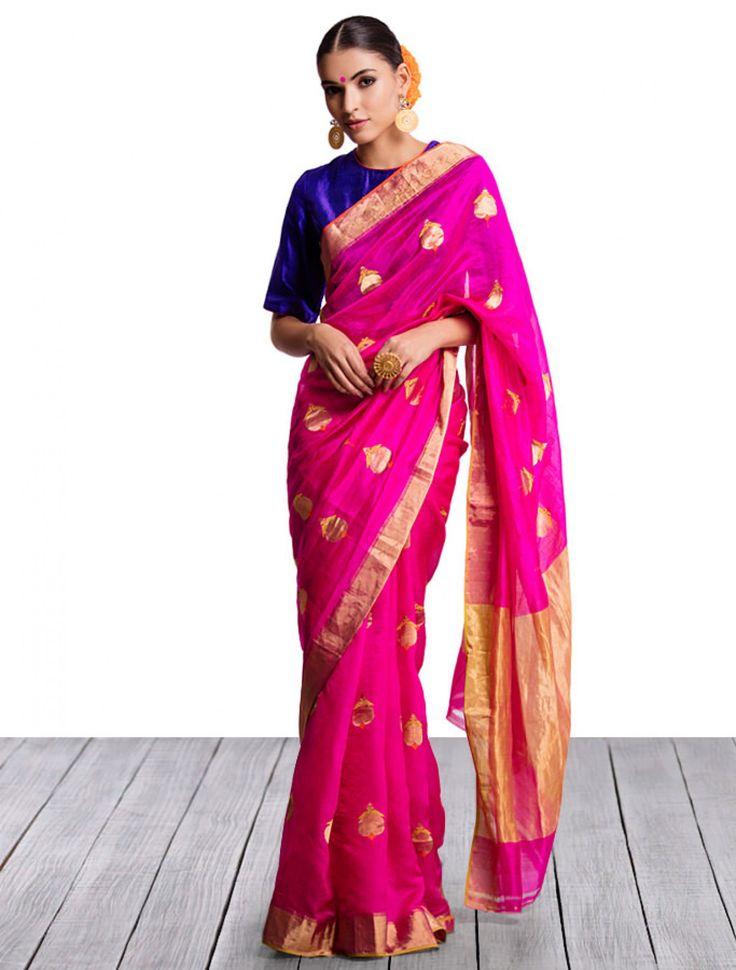 Pink and gold silk saree with dark blue blouse. Indian fashion.