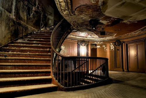 An abandoned theater.  The staircase is so beautiful...