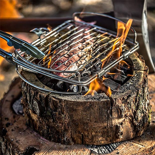 Burnie Grill  Burnie is a self-burning all-wood, 100% natural grill that creates zero waste, requires no lighter fluid, contains no chemicals & requires no clean up. Simply unwrap it, hold a match to the center & it burns for hours. Could cooking at camp get any easier?