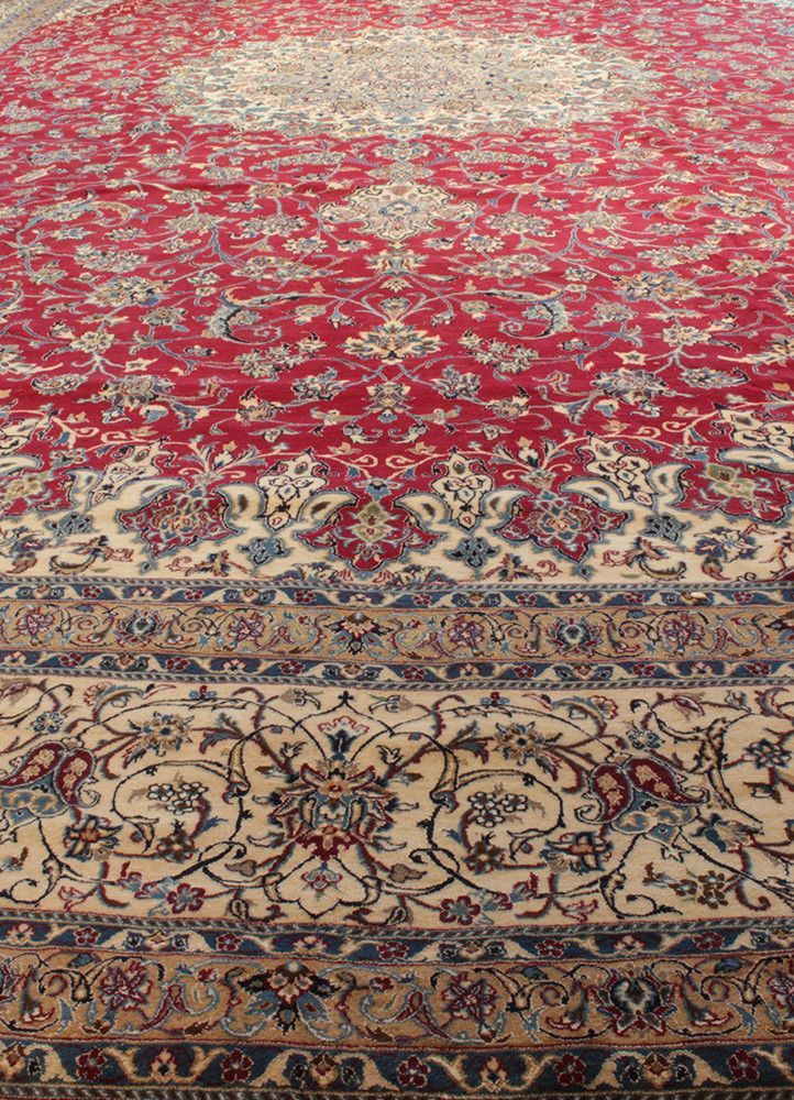 Nain rugs are constructed using the Persian knot and typically have between 300 and 700 knots per inch. The pile is usually very high quality wool, clipped short, and silk is often used as highlightin