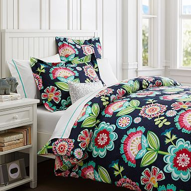 If you prefer a light and bright bedroom but still want a more 'grown up' look, this doona (duvet) cover with its funky florals on a black background fits the bill.