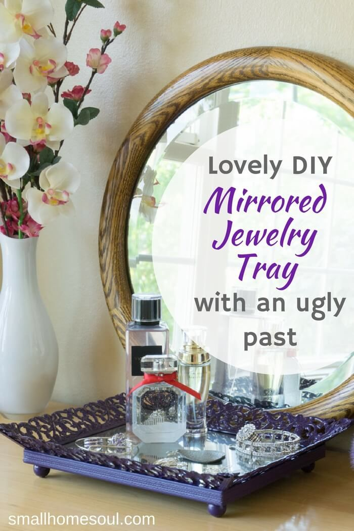 Make your own stylish mirrored jewelry tray from an old picture frame. Perfect for bedroom, bathroom, or even table top living room decor. #DIYDecor #Bathroom #Bedroom #Upcycle
