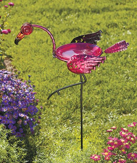 A new take on the plastic flamingo! This glass and metal stake acts as a bird bath or bird feeder. |The Lakeside Collection