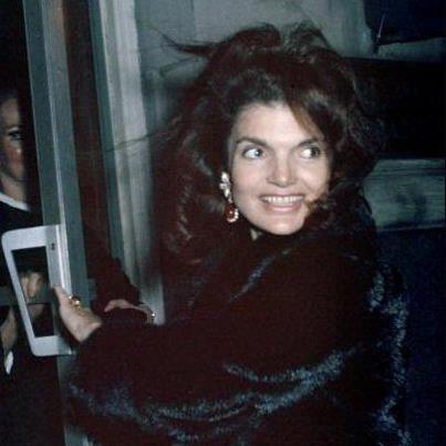 Wearing the Onassis ruby earlings, a wedding present.  (www.pinkpillbox.com)