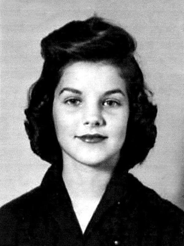 Young Priscilla Presley in a Black Buttondown Blouse