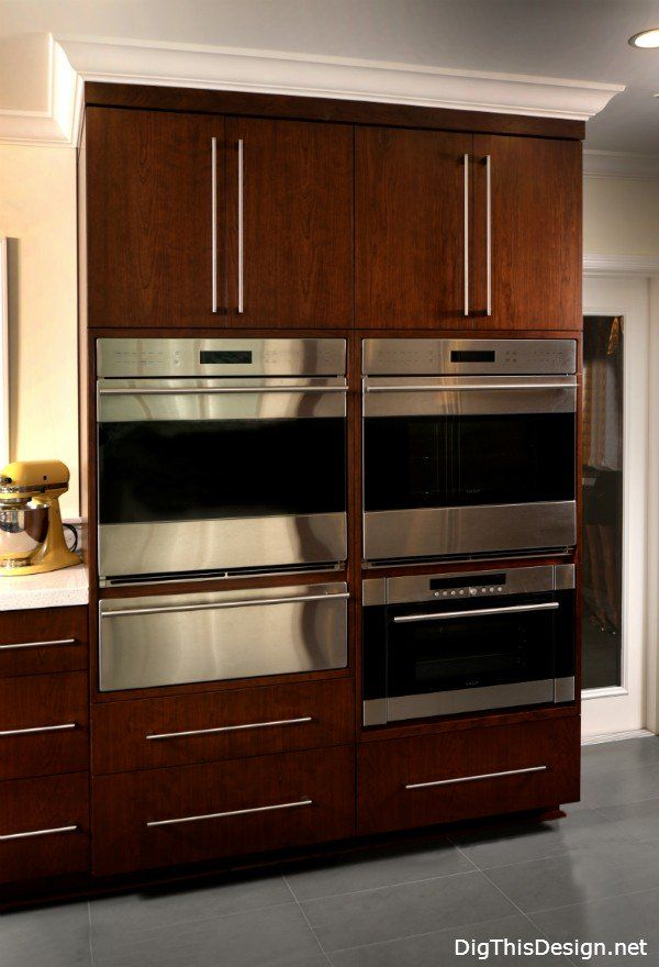 double ovens in tall cabinet, double ovens, warming drawer and convection oven in contemporary kitchen design