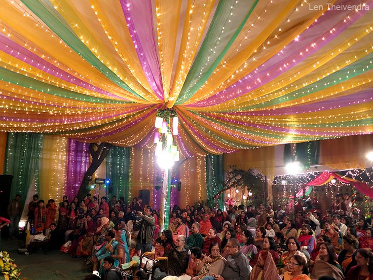 The Holud, a night of song and dance. It begins as the groom's side enters, carrying the bride's wedding outfit, jewelry, decorations, and other gifts. The bride's side then follows with gifts of their own for the groom. The venue for the Holud was this colorful marquee in #Dhaka, #Bangladesh #Wedding