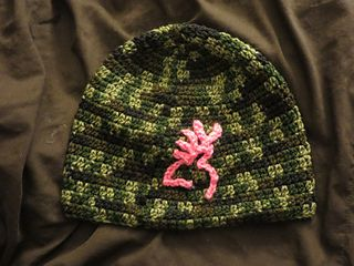 This applique is based on the Browning deer logo/symbol. You can vary the size by using different hooks and weights of yarn.