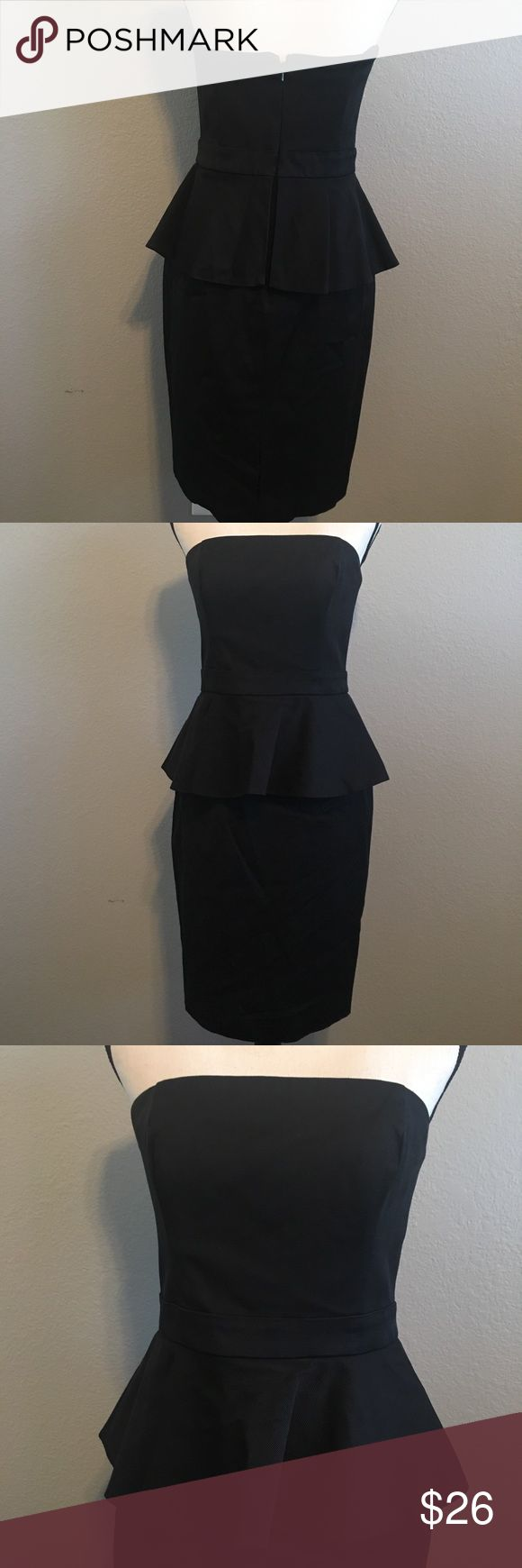 """White House Black Market Black Peplum Dress WHBM Black Strapless Peplum Dress. Has caged top with slip grips to help keep the dress in place. Thicker material, bottom skirt has some stretch to it.    Chest: 30"""" (flat) with a few extra inches for chest.  Waist: 28"""" Hips: 37"""" Length: 30"""" White House Black Market Dresses Strapless"""