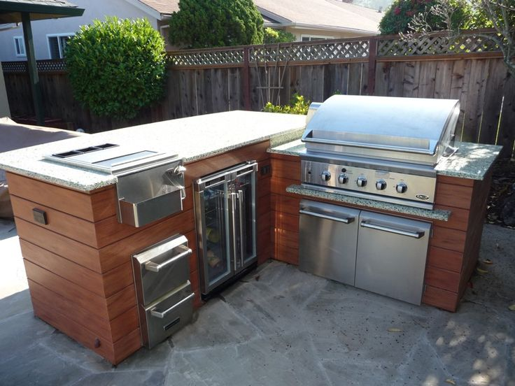 Bbq island like the tiimber tech faux wood facing