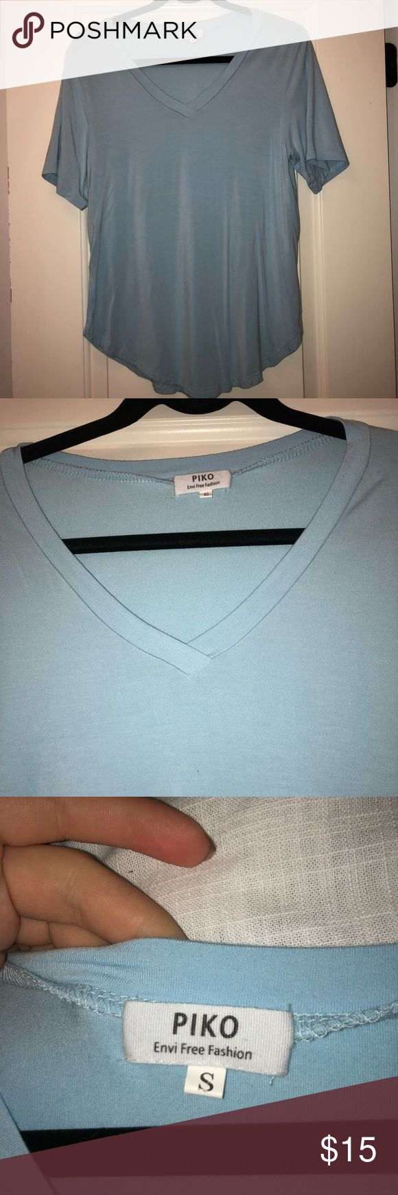 V-Neck Short Sleeve Piko Shirt Sooo cute and such a pretty color. Love this shirt for UNC games, it is the perfect color Piko 1988 Tops Tees - Short Sleeve